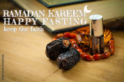 A couple of dates with rosary and holy quran over the wood written