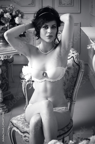 2713d0d77c1 Sexy and attractive woman in white lingerie and pearl jewelry in luxury  interior