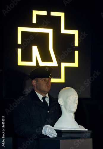 A man places mask of member of German rock band Rammstein