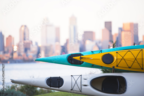 Kayaks stacked on rack on background of Seattle downtown Poster