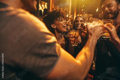 Obraz Young friends at nightclub having party - fototapety do salonu
