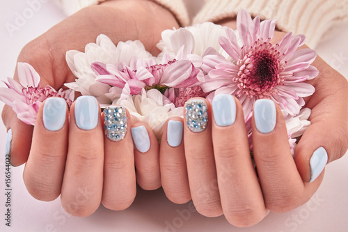 White and pink chrysanthemums, gentle decoration for manicure.