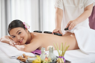 Obraz na płótnie Canvas Pretty Client Enjoying Stone Massage