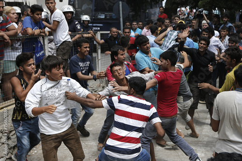 Pakistani iranian and afghani migrants scuffle outside the police pakistani iranian and afghani migrants scuffle outside the police station of the city of kos thecheapjerseys Image collections
