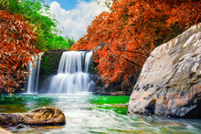 Waterfall In Autumn Forest And...