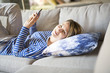 woman sitting on the couch take some good time with cellphone