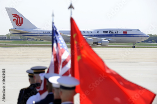 A color guard of US and Chinese flags awaits Hu's plane as he