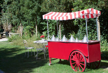 Red Ice Cream Cart In The Gard...