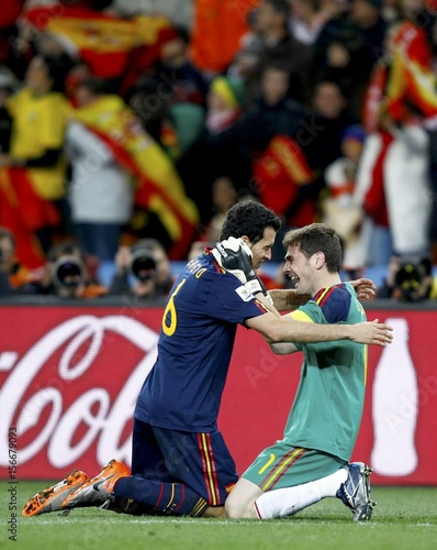 e0015fc88f5 Spain s goalkeeper Iker Casillas celebrates with teammate Sergio Busquets  after winning their 2010 World Cup final