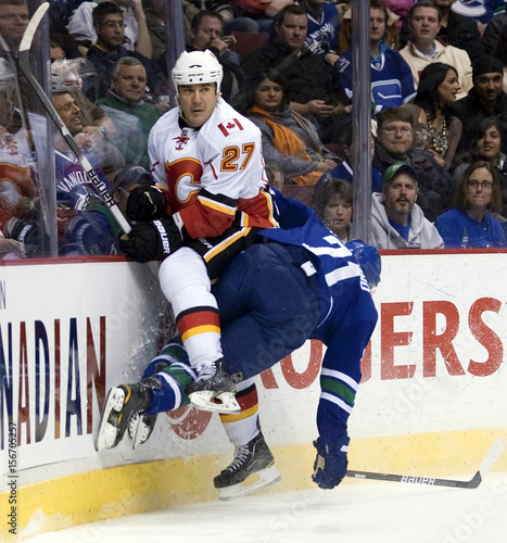 super popular ddd5c 9ae27 Calgary Flames Steve Staios checks Vancouver Canucks Mason ...