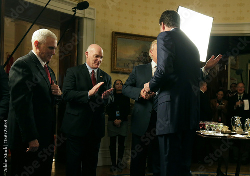 Donald trump greets james comey as mike pence and joseph clancy donald trump greets james comey as mike pence and joseph clancy watch during the inaugural law enforcement officers and first m4hsunfo