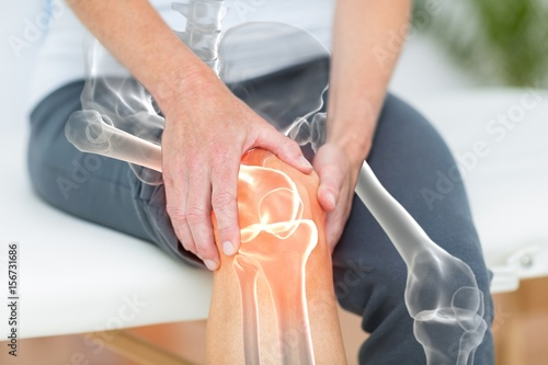 Fotografia  Mid section of man suffering with knee pain