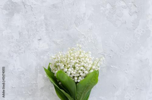 Poster Muguet de mai Lily of the valley bouquet on a concrete texture