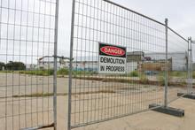 Danger, Demolition In Progress Sign At A Work Site