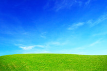 Green Grass Hills And Blue Sky.