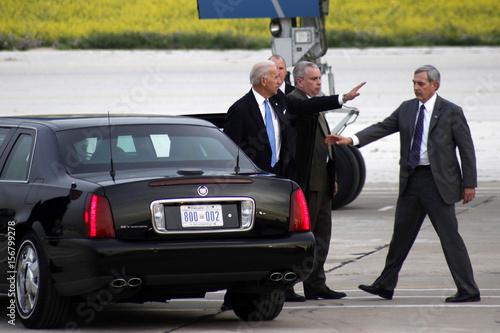 U S  Vice President Joe Biden wave to U S  Ambassador to