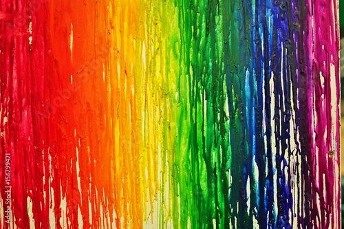 LGBTQ pride rainbow flag painted with colorful bleeding paint  streaks on a wall Fotobehang