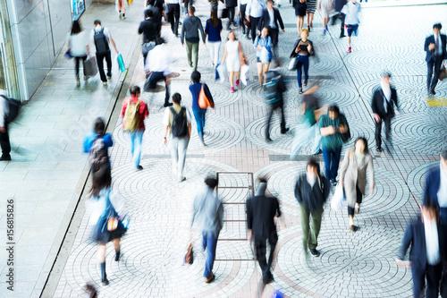 Fototapeta crowde people on street in modern city obraz