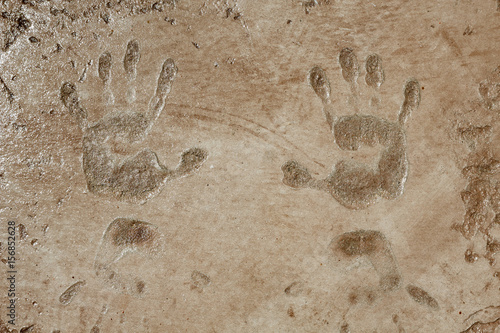 Poster Betonbehang Textured pattern concrete with hand stamps