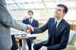 Handshake of successful bankers or lawyers before meeting