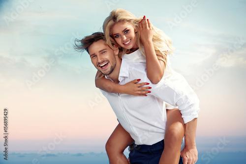 Poster Artist KB Handsome man carrying his girlfriend piggyback