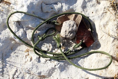 Photo  Ancient weapon - Sling for stone throwing.