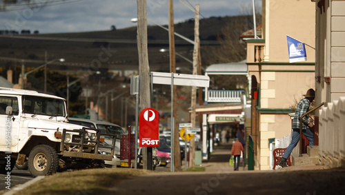 Farmer enters the post office on the main street of the Eden