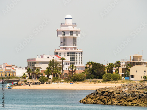 Montage in der Fensternische Leuchtturm The lighthouse, at Isla Cristina and the beach Playa el Cantil, as seen from Punta del Moral, near Ayamonte, Huelva Province, Andalucia, Spain