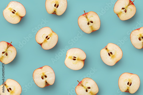 Valokuva  Apple slices pattern on a blue background