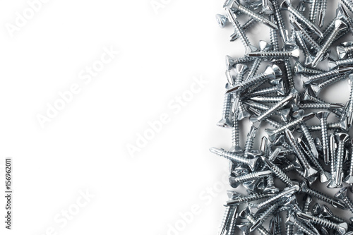 Obraz Driller dowel and screw isolated on white background - fototapety do salonu