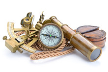 Compass,sextant And Spyglass On The White