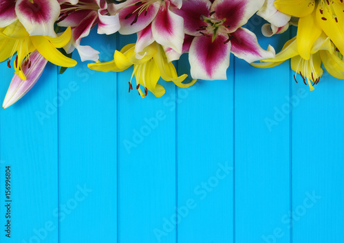 Wall Murals Green coral lily flowers on wooden planks