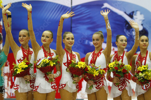 Russia's gold medal team celebrates on the podium after performing