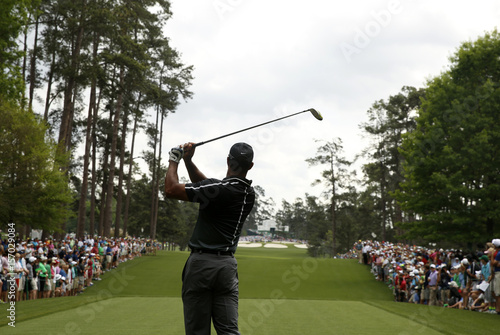 Tiger Woods of the U.S. hits off the seventh tee during second round ...