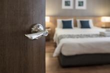 Condominium Or Apartment Doorway With Open Door In Front Of Blur Bedroom Background