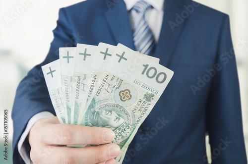 Pinturas sobre lienzo  Range of Polish banknotes in businessman hand