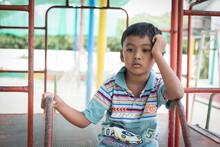 Cute Asian Little Boy Sad Alone At Playground