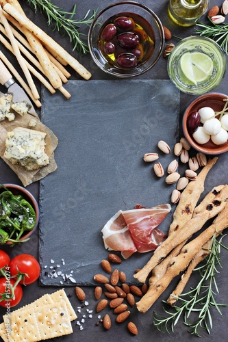 Staande foto Voorgerecht Appetizers table concept for mediterranean lunch or dinner. Overhead view. Copy space