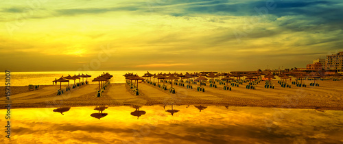 Poster de jardin Jaune Panoramic image of sunrise on the beach in Mallorca. Europe. Spain