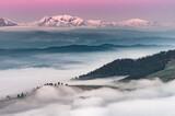 Piękna wiosenna panorama nad mglistym górskim Spiszem zaśnieżone Tatry rano, Polska - 157154658