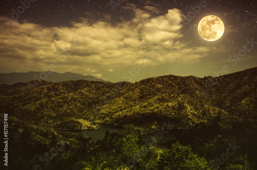 Foto op Plexiglas Chocoladebruin Landscape of blue dark night sky with many stars and cloudy.
