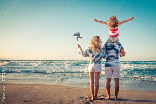 Tablou Canvas Happy family having fun on summer vacation