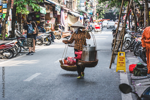 Vietnamese Street Vendor with Baskets