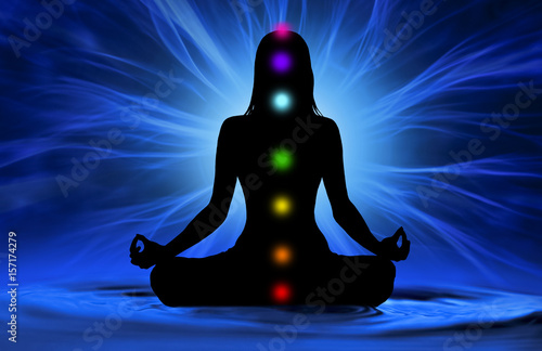 Fotografie, Obraz  Silhouette of woman doing yoga and where has scored seven chakra points