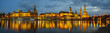 view of the historic part of Dresden, city lights reflecting on the River Elbe.