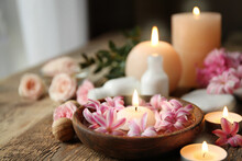 Beautiful Spa Composition With Flowers And Candles On Wooden Table