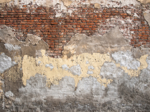 Poster Vieux mur texturé sale Damaged brick wall with peeling plaster background for design
