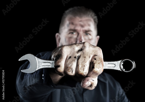 fototapeta na drzwi i meble Mechanic holding wrench