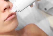 Woman Getting Laser Treatment ...
