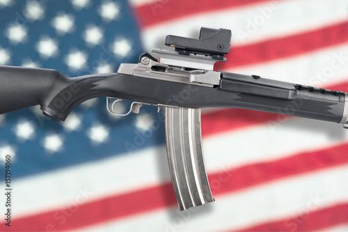 Fotografie, Obraz  Assault rifle on flag
